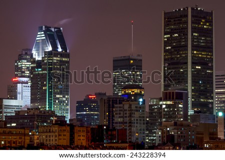 Montreal,Quebec,Canada- November-04-2010: Part of Old Montreal and a Skyscraper in the background at Night - stock photo