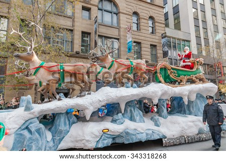 MONTREAL, QUEBEC, CANADA - NOVEMBER 21, 2015 : Santa Claus sleigh at the 65th edition of the Santa Claus Parade Destination Centre-ville (Defile du Pere Noel) along Saint Catherine Street. Bright sun - stock photo