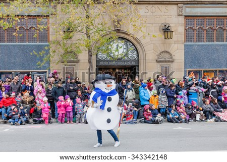 MONTREAL, QUEBEC, CANADA - NOVEMBER 21, 2015 : Snowman in the 65th edition of the Santa Claus Parade Destination Centre-ville (Defile du Pere Noel) along Saint Catherine Street. - stock photo
