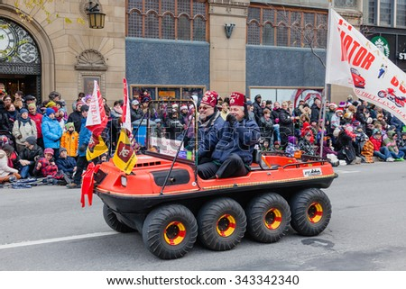 MONTREAL, QUEBEC, CANADA - NOVEMBER 21, 2015 : The 65th edition of the Santa Claus Parade Destination Centre-ville (Defile du Pere Noel) along Saint Catherine Street. - stock photo
