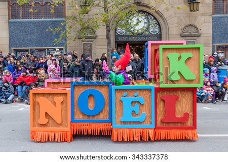 MONTREAL, QUEBEC, CANADA - NOVEMBER 21, 2015 : Toy building blocks platform in the 65th edition of the Santa Claus Parade Destination Centre-ville (Defile du Pere Noel) along Saint Catherine Street. - stock photo