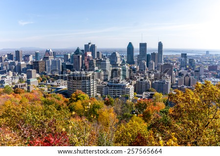 Montreal,Quebec,Canada-October 14-2014: Autumn Colourful trees, and in the background, the downtown of Montreal, view to  Mount Royal Park, with some little bit Numeric noise.  - stock photo