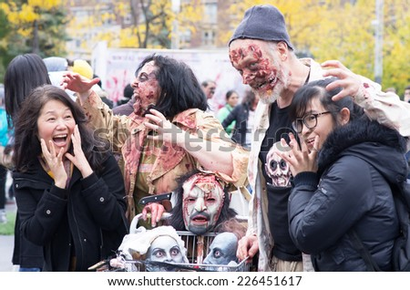 MONTREAL, QUEBEC, CANADA - OCTOBER 25 - Montreal Zombie Walk. A zombie walk is a public manifestation, where participants walk around dressed as zombies and have zombie makeup - 2014/10/25