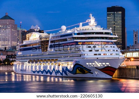 Montreal,Quebec,Canada- September 23 - 2010 : AIDA LUNA cruise ship docked in the port of Montreal. at Dusk  In all the years, this boat comes to visit us in Montreal.  - stock photo