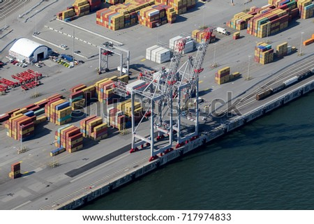 Montreal, September 10, 2017. Aerial view over the Port of Montreal looking at containers and loading cranes on the pier.