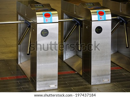 MONTREAL - SEPTEMBER 27: Turnstiles for the Montreal Metro located in Montreal, Quebec on September 27, 2011. The Montreal Metro is the main form of public transportation for the city of Montreal. - stock photo