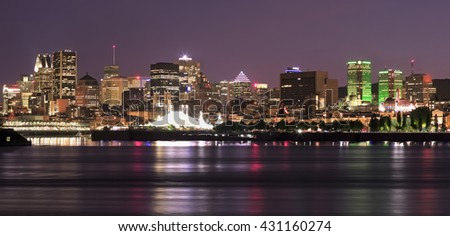 Montreal skyline and St Lawrence River at night  - stock photo