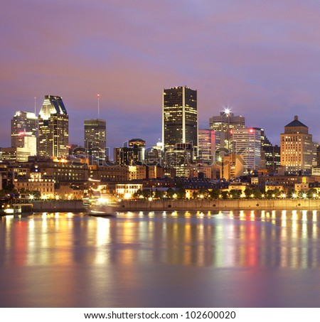 Montreal skyline at dusk, Saint Lawrence River - stock photo