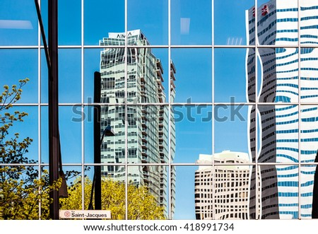 Montreal skyscrapers reflections on Saint-Jacque street in downtown - stock photo