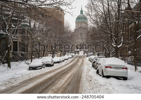 Montreal Ste-Famille Street filled with fresh snow during a snow storm - stock photo