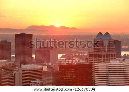 Montreal sunrise silhouette viewed from Mont Royal with city skyline in the morning - stock photo