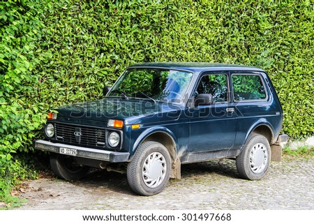 MONTREUX, SWITZERLAND - AUGUST 6, 2014: Motor car Lada Niva at the city street. - stock photo