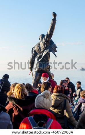 MONTREUX, SWITZERLAND - DEC 06, 2015: Freddie Mercury statue on waterfront of Geneva lake in Montreux, Switzerland during Christmas Market