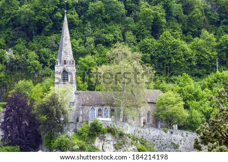 MONTREUX, SWITZERLAND - MAY 20, 2013: Temple Saint-Vincent, the former Catholic church, known as the temple of Montreux due to its Protestant faithful, rebuilt after a fire in 1476,  restored in 1968 - stock photo