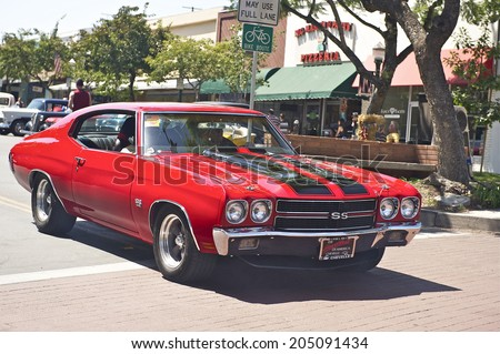 MONTROSE/CALIFORNIA - JULY 6, 2014: Classic 1970 Chevelle SS 396 as it departs the Montrose Hot Rod & Classic Car Show. July 6, 2014 Montrose, California USA - stock photo