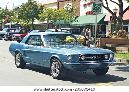 MONTROSE/CALIFORNIA - JULY 6, 2014: Classic Ford Mustang as it departs the Montrose Hot Rod & Classic Car Show. July 6, 2014 Montrose, California USA - stock photo