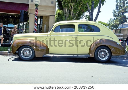 MONTROSE/CALIFORNIA - JULY 6, 2014: 1940 Ford Deluxe 2 Door Sedan owned by Ken Sweet at the Montrose Hot Rod and Classic Car Show. July 6, 2014 Montrose, California USA - stock photo