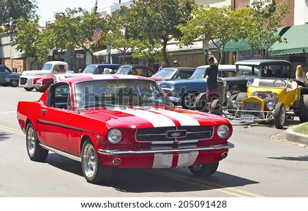 MONTROSE/CALIFORNIA - JULY 6, 2O14: Classic1962 Ford Mustang Fastback 2+2 owned by Nick Sfetko as it departs the Montrose Hot Rod & Classic Car Show. July 6, 2014 Montrose, California USA  - stock photo