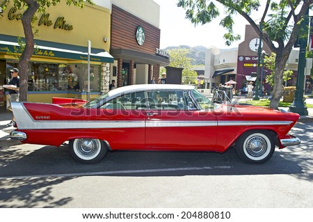 MONTROSE, CALIFORNIA - JULY 6, 2014: 1958 Plymouth Belvedere owned by M.E. Niedringhaus at the Montrose Hot Rod & Classic Car Show. July 6, 2014 Montrose, California USA. - stock photo