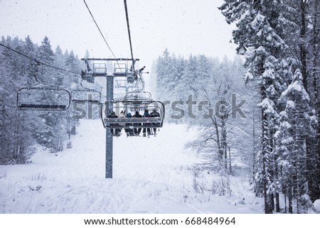 Monts Jura, France- Jan 16, 2016. Peoples and ski cable cars in heave snow at Monts Jura. France