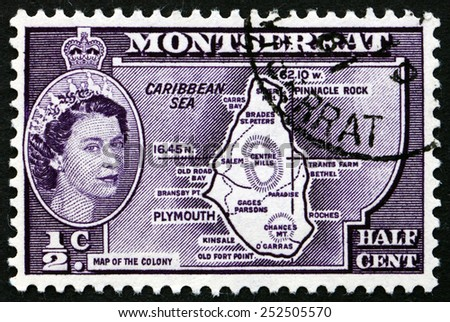 MONTSERRAT - CIRCA 1956: a stamp printed in Montserrat shows Map of Montserrat with Portrait of Queen Elizabeth II, circa 1956 - stock photo