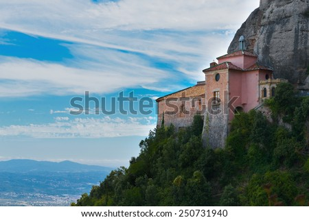 Montserrat is a mountain near Barcelona, in Catalonia. View of the chapel of Santa Cova  - stock photo