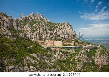 Montserrat Monastery is a spectacularly beautiful Benedictine. Abbey high up in the mountains near Barcelona, Catalonia, Spain  - stock photo