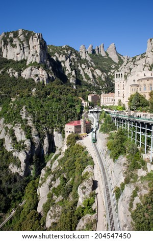 Montserrat mountains and rack railway to the Santa Maria de Montserrat Benedictine monastery in Catalonia, Spain.