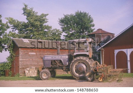 MONTVILLE, MICHIGAN - CIRCA 1980's: Tractor in front of a barn in Mottville, MI
