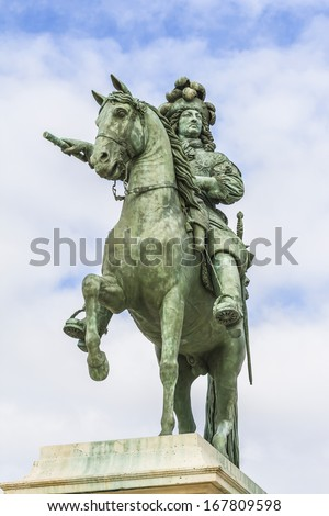 Monument by Louis XIV in front of Versailles Palace. Palace Versailles was a royal chateau. It was added to UNESCO list of World Heritage Sites.Versailles, Paris, France. - stock photo