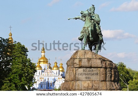 Monument of Bohdan Khmelnytsky, the Hetman of Ukrainian Zaporozhian Cossacks, on Sofia square in Kyiv, Ukraine. St. Michael's Golden-Domed Monastery on the background - stock photo
