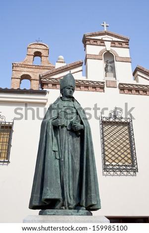 Monument of Cardinal Francisco Jimenez de Cisneros in Alcala de Henares, Madrid - stock photo
