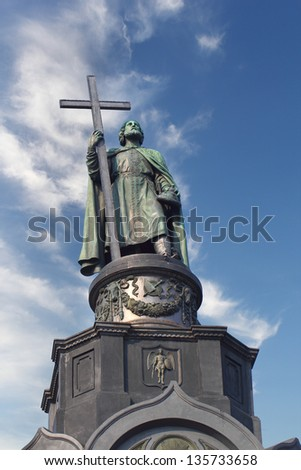 Monument of Vladimir the Great holding a cross over blue cloudy sky, Kiev, Ukraine