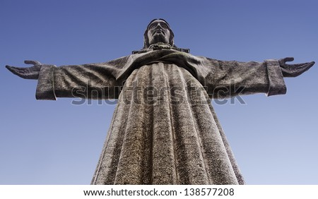 Monument to Christ the King (Cristo-Rei) near Lisbon, in Almada at the opposite side of Tagus Estuary. Built by OPCA Enterprise 1952 - 1959. - stock photo