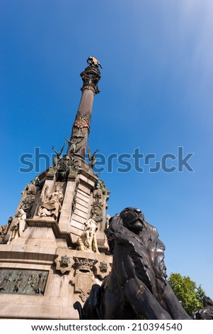 Monument to Christopher Columbus - Barcelona / Column of Barcelona, Spain, monument dedicated to the famous Italian navigator Cristorofo Colombo. On the left the building of the military government - stock photo