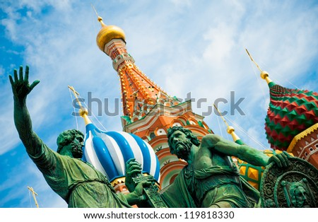 Monument to Minin and Pozharsky on the Red Square in Moscow Russia. Saint Basil's Cathedral on the background. - stock photo
