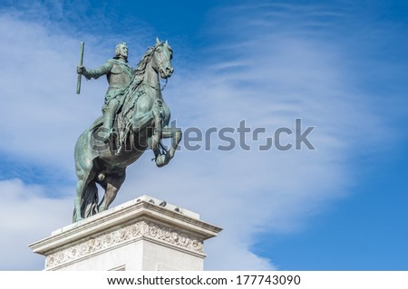 Monument to Philip IV on Plaza de Oriente Central Gardens located between the Royal Palace and the Royal Theatre in Madrid, Spain.