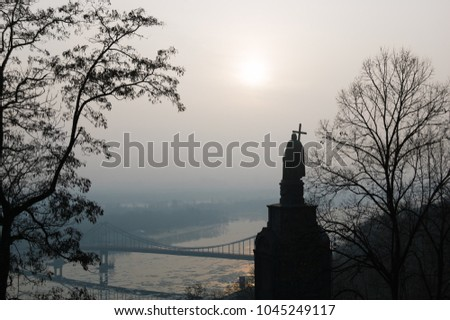 Monument to Vladimir the Great. Historic landmark. View of the Dnipro River. The city of Kiev, Ukraine. Autumn morning with a fog