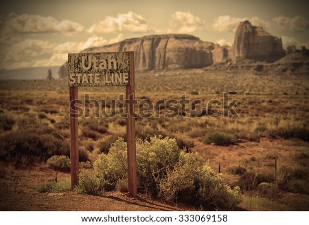 Monument Valley and Utah State line sign in the old west - stock photo