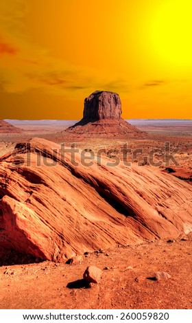 Monument Valley Arizona with evening warm skies and sunrise - stock photo
