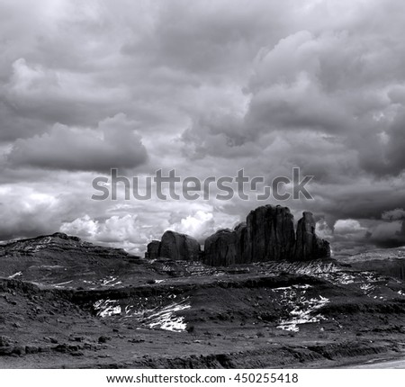 Monument Valley Arizona with stormy cloudy skies blank and white