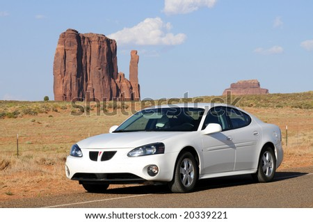 MONUMENT VALLEY, AZ - JUNE 22: Sales of Pontiac Grand Prix, pictured in an iconic desert setting in Monument Valley, Arizona, on June 22, 2008, are down because of high gas prices. - stock photo