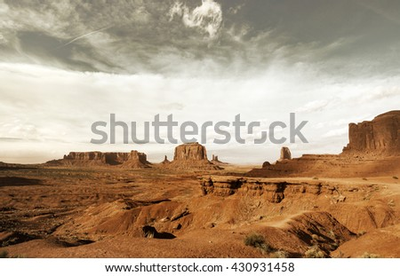 monument valley landscape in a gloomy day - stock photo
