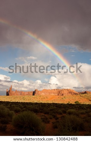 Monument Valley lights up after a storm - stock photo