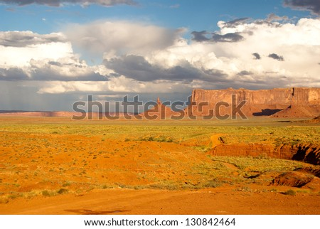 Monument Valley National Park in bright afterglow from Summer storm - stock photo