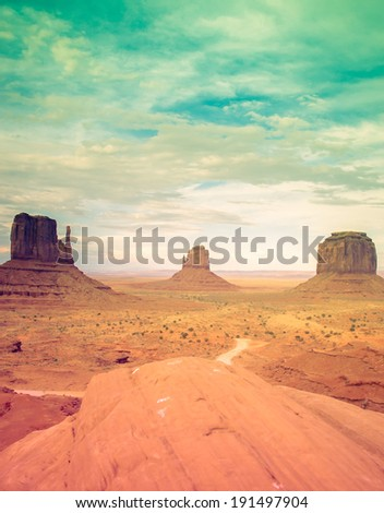 Monument Valley national park with retro processing. Desert Sunset - stock photo