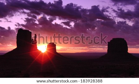 Monument Valley 09 Sunrise Left & Right Mitten Butte Arizona and Utah - stock photo