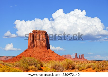 Monument Valley, USA colorful desert landscape of Navajo Nation Park in Utah and Arizona on a beautiful summer day - stock photo