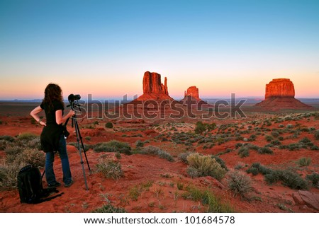 monument valley with nice sunset, being photographed, focus on rocks - stock photo