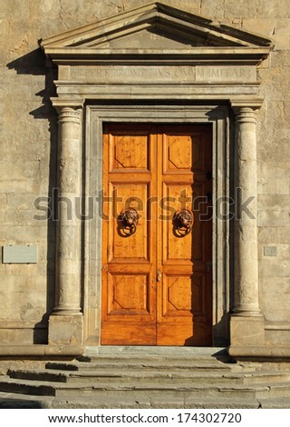 monumental door to the Palazzo Bartolini Salimbeni in Florence, Italy - stock photo